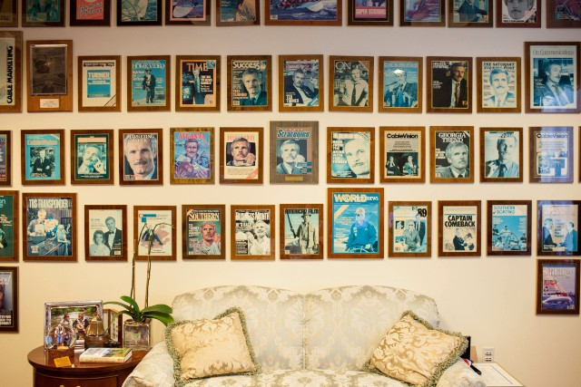 Framed magazine covers adorn a wall in Ted Turner's Atlanta office.