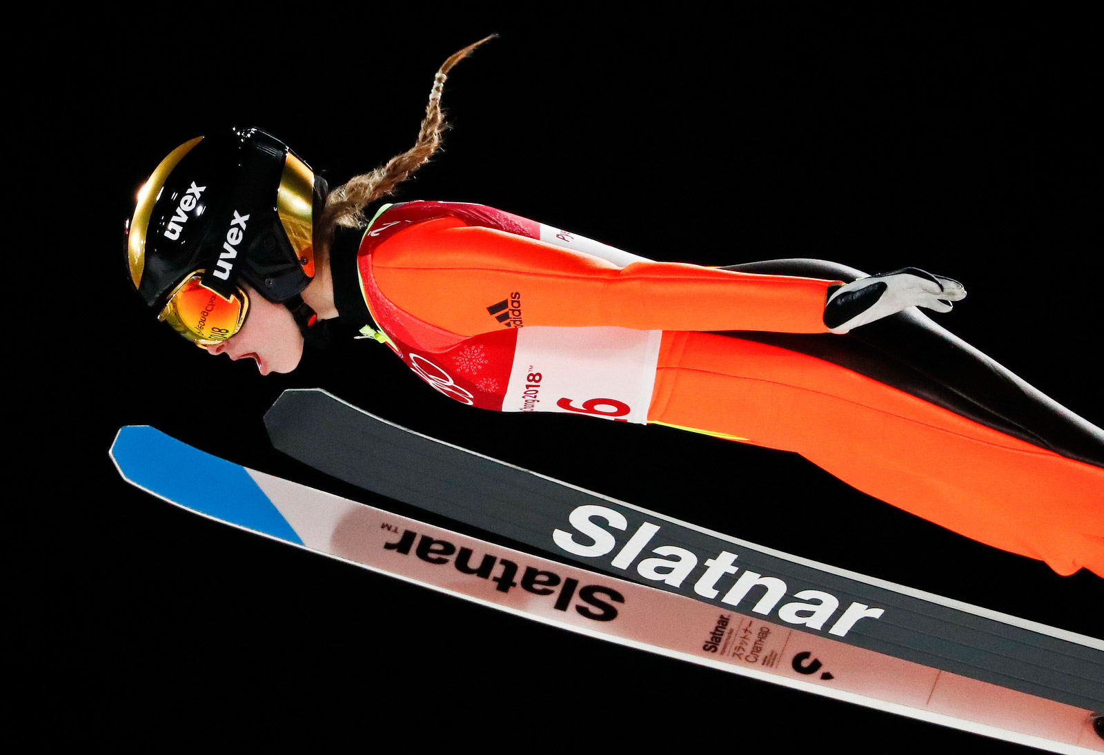 Slovenian ski jumper Nika Kriznar soars through the air on February 12. Matthias Schrader/AP