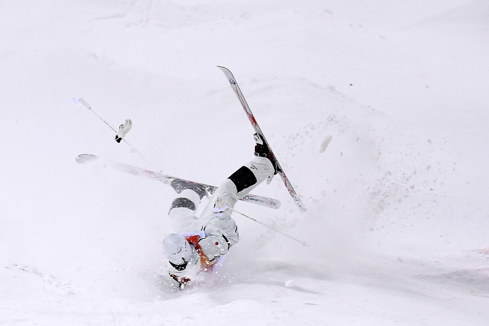 Japanese skier Ikuma Horishima crashes during the moguls event on February 12. David Ramos/Getty Images