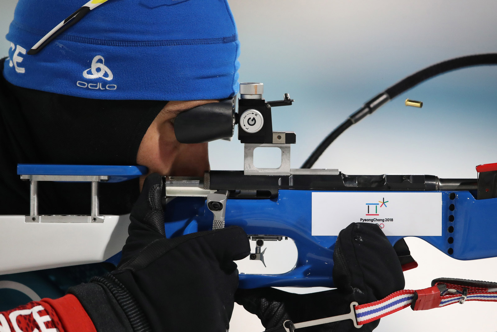 A bullet shell flies from the rifle of French biathlete Martin Fourcade, who won the 12-kilometer pursuit on February 12. It's the third gold medal of Fourcade's career and the fifth medal in all. He is the most decorated French athlete in Winter Olympics history. Sean M. Haffey/Getty Images