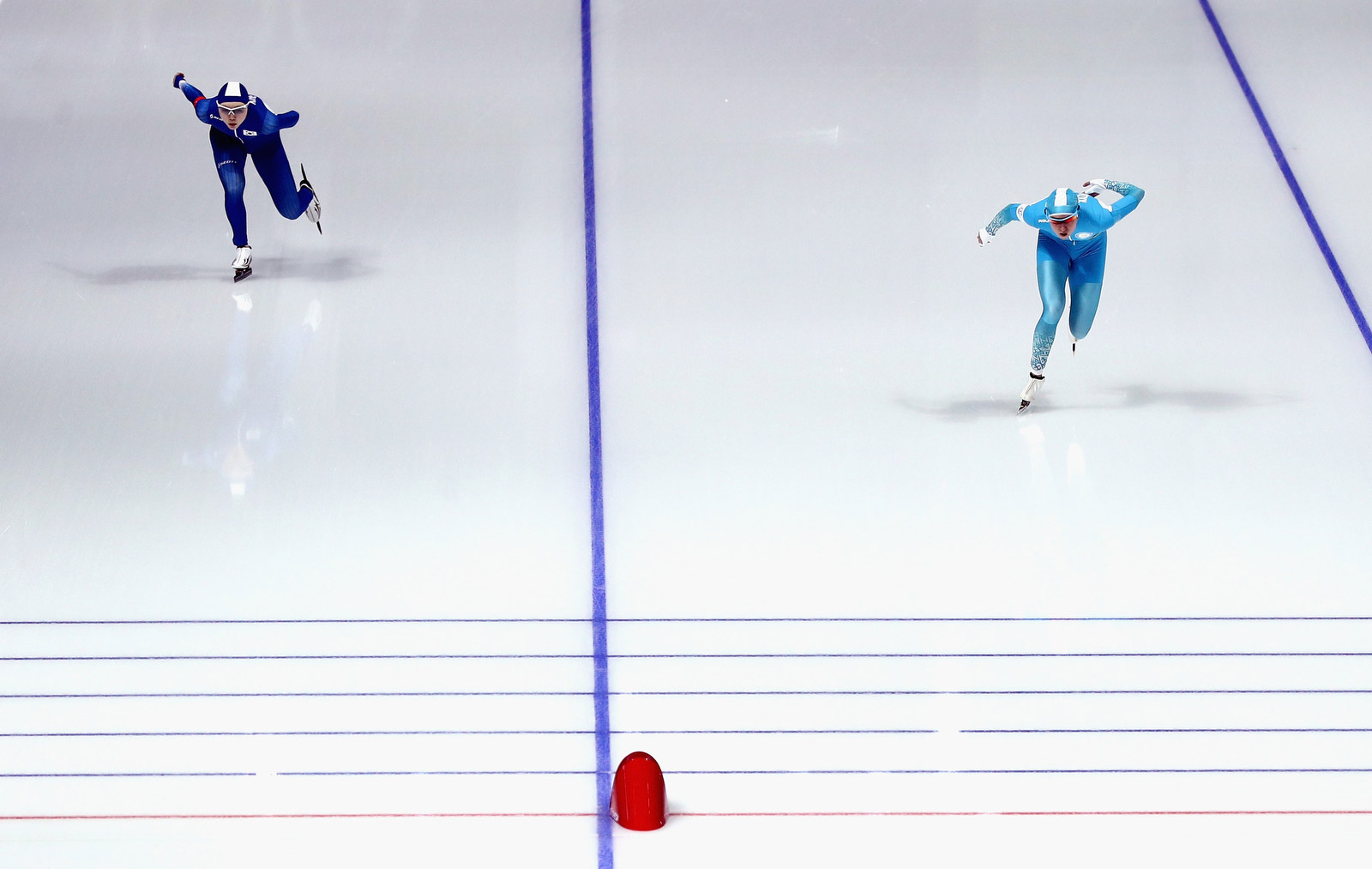 South Korea's Noh Seon-yeong, left, and Kazakhstan's Yekaterina Aidova skate in the final of the 1,500 meters. Maddie Meyer/Getty Images