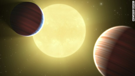 This artist rendition obtained from NASA shows planets the size of Saturn orbiting a distant star. Astrophysicists using the Kepler space telescope have detected two planets the size of Saturn and a possible third the size of Earth orbiting a distant star, a report published August 26, 2010, said.