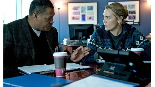 "Laurence Fishburn and Kate Winslet in a scene from the Warner Bros. movie ""Contagion."""