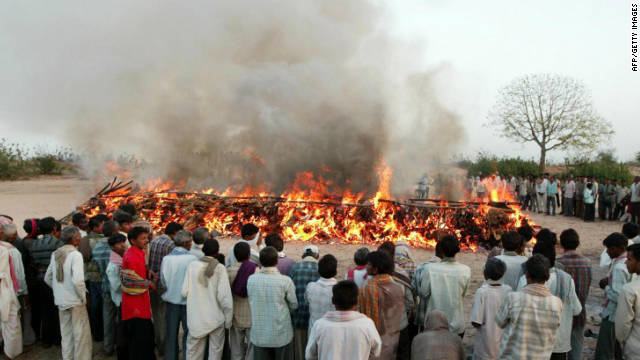 Indians pay last respects at a mass cremation of 15 school girls at the banks of the river Orsang in Bamroli on April 16, 2008.