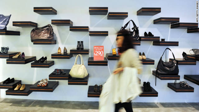 A shopper passes by a shop display in Hong Kong on August 29, 2011.