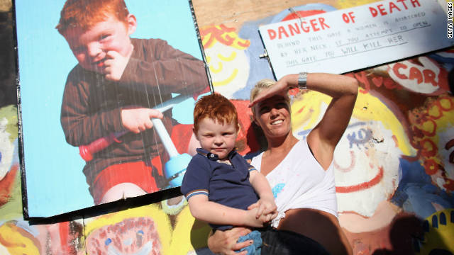 Traveller Serena McCarthy holds her nephew Michael Flynn, 3, at the entrance to Dale Farm traveller's camp as news breaks of a temporary injunction against the camp's eviction on September 19, 2011 in Basildon, England
