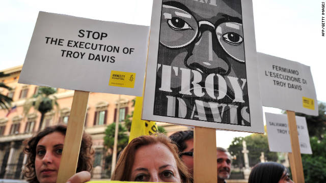 Amnesty International activists hold banners in support of Troy Davis at the U.S. Embassy in Rome on Friday.