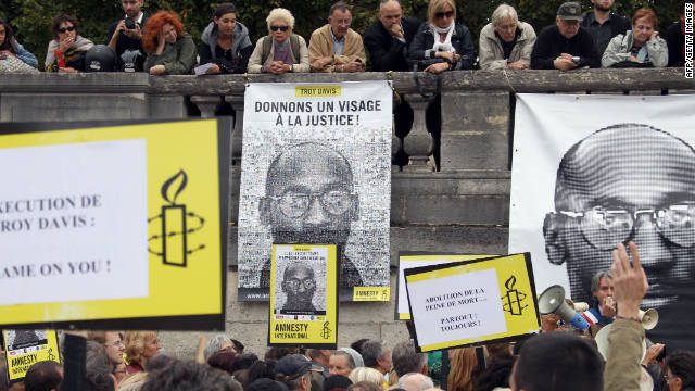 People hold placards on Wednesday during a demonstration in Paris against the execution of Troy Davis.