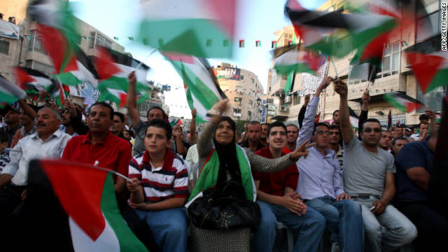 Palestinians watch Mahmoud Abbas' U.N. speech live on a wide screen set up in a Ramallah square. Hundreds gathered.