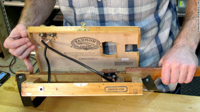 The inside of the cigar box guitar reveals its craftsmanship.
