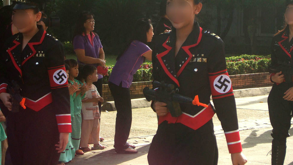 Students from the Sacred Heart School in Chiang Mai, Thailand took part in a parade wearing Nazi uniforms. Faces have been blurred to protect their identity.