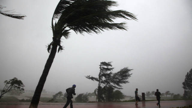 Residents on southern China's Hainan island  hit by Typhoon Nesat.