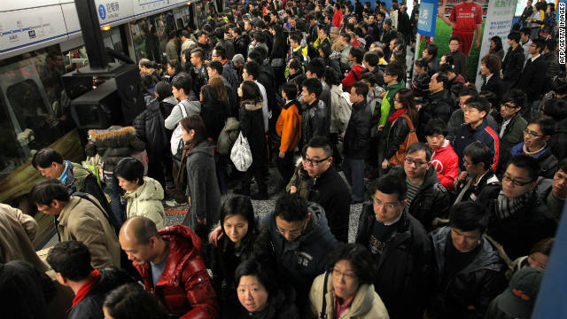 Travellers prepare to board a mass transit railway (MTR) train in Hong Kong on January 29.