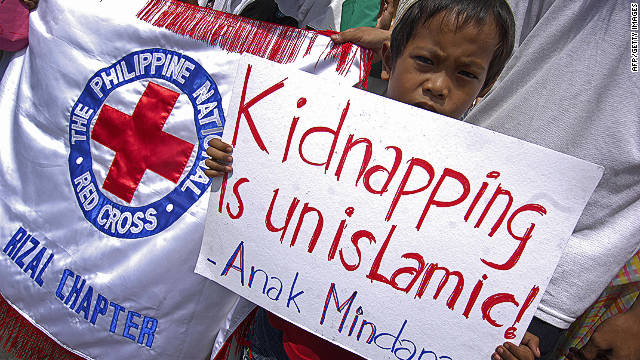 Muslim children show placards during a protest for peace in suburban Manila in 2009.