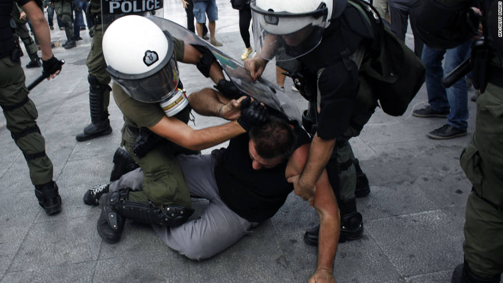 Police arrest a protester during Wednesday's rally in Athens.