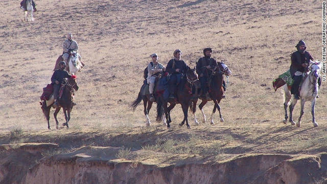 U.S. Special Operations Forces ride into northern Afghanistan in October 2001 on horseback