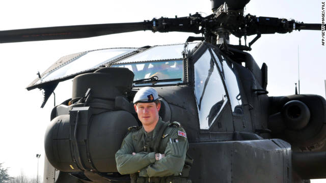 Prince Harry stands in front of his Apache helicopter while he was in the French Alps on his Mountain Flying training in March.