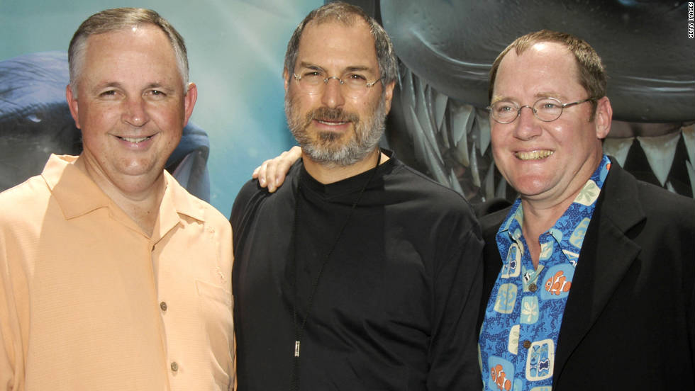 "Disney's Dick Cook, <a href=""http://www.cnn.com/specials/tech/steve-jobs-the-man-in-the-machine"">Jobs</a> and producer John Lasseter pose for photographers at the premiere of ""Finding Nemo"" in Hollywood on May 18, 2003."