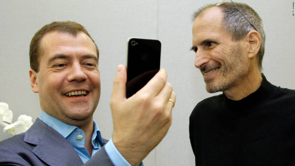 "Russian President Dmitry Medvedev, left, admires his new iPhone 4 from <a href=""http://www.cnn.com/specials/tech/steve-jobs-the-man-in-the-machine"">Jobs</a> on Medvedev's tour of Silicon Valley in June 2010."