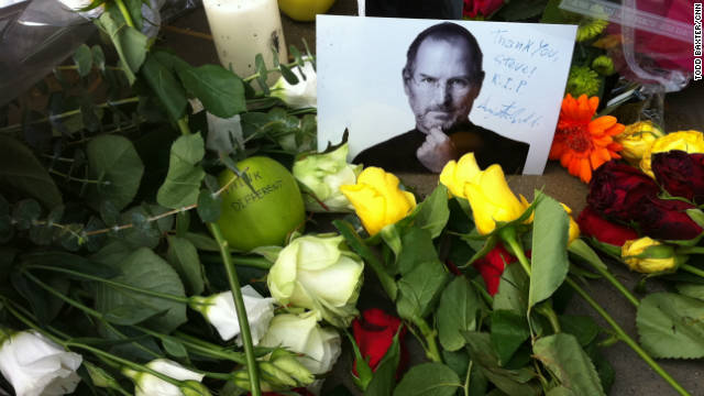 A memorial in front of the Apple store on Regent Street in London pays tribute to Apple co-founder Steve Jobs.