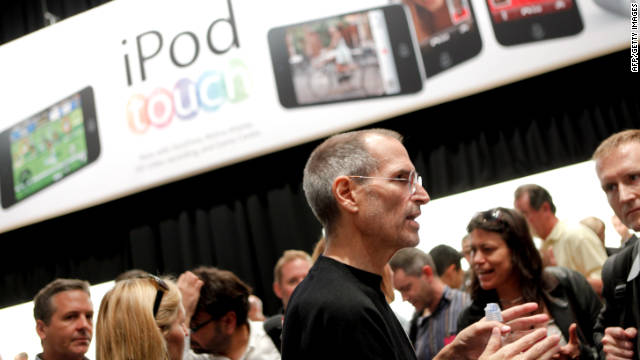 Steve Jobs talks to reporters after announcing the release of product upgrades at a news conference in San Francisco in 2010.