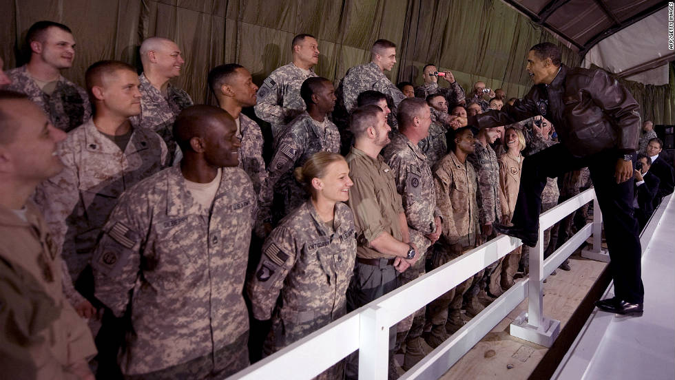 President Barack Obama visits with troops at Bagram Air Base on March 28, 2010. Obama thanked the Afghan people and U.S. troops for their sacrifices and vowed to reverse the Taliban's momentum. It was his first visit to Afghanistan as president.