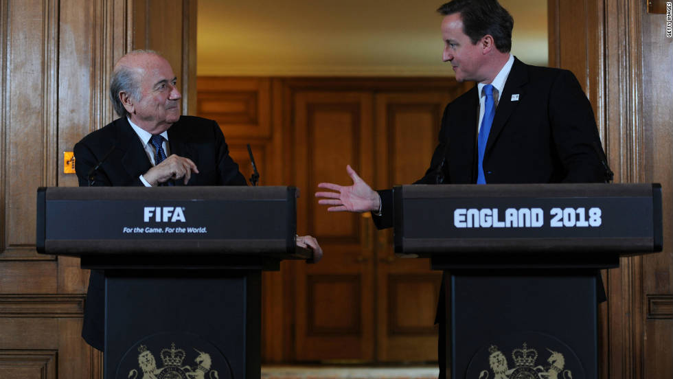 """It is a sad day for football,"" FIFA president Sepp Blatter, pictured here meeting British Prime Minister David Cameron a week earlier, tells reporters in Zurich."