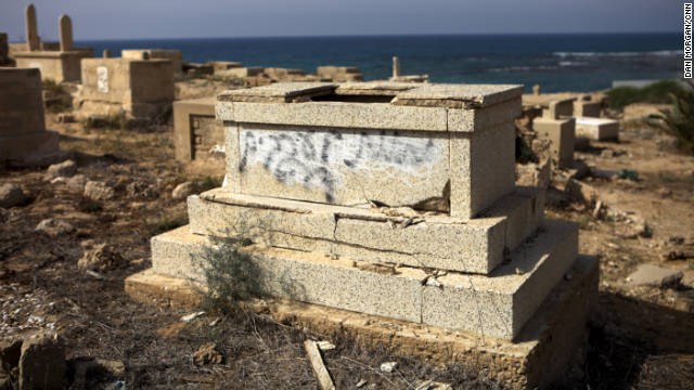 "The words ""death to all Arabs"" are sprayed on this tombstone in the Muslim cemetery in Jaffa, Israel."