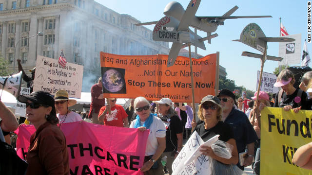 Protesters against the war in Afghanistan and government spending march to the Air and Space Museum for Occupy D.C.