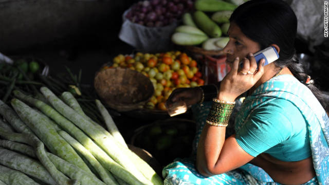 This April 17, 2009 shows an Indian vendor using her mobile phone to take customers orders at a wholesale market on the outskirts of Hyderabad. On May 22, 2011 experts reported that hundreds of millions of poor Indians who have no access to financial services could benefit from mobile banking, as cell phone use grows at breakneck pace.