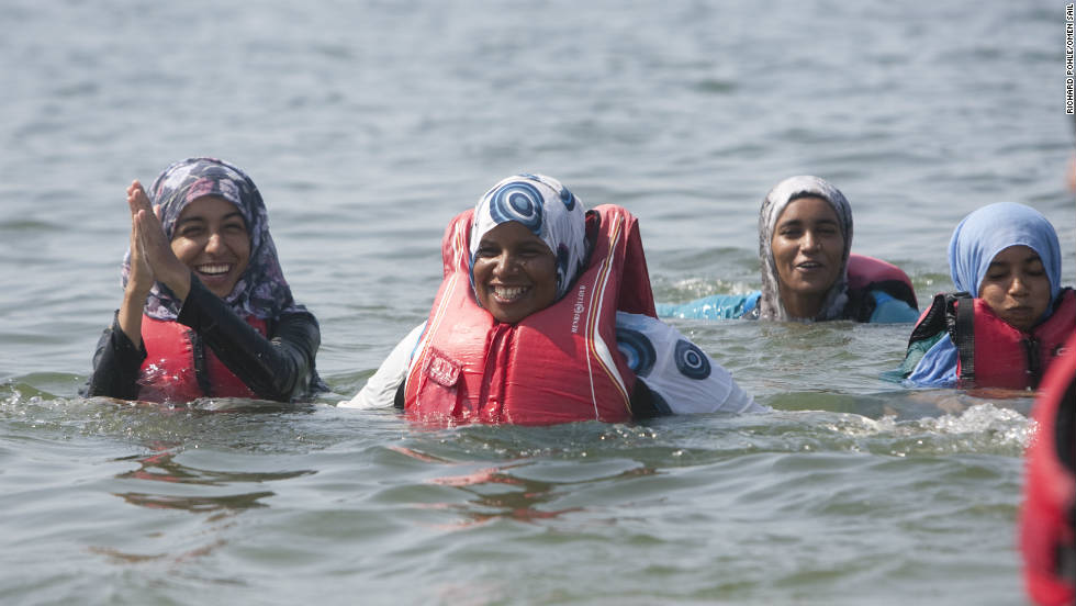 Following a training session in Massana, the female trainee sailors relax by jumping into the water.