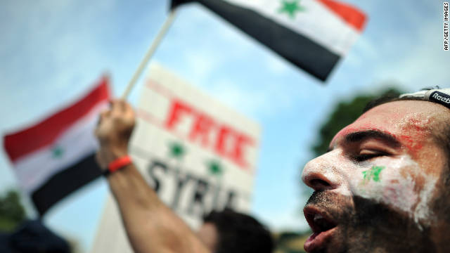 A man shouts slogans against the Syrian government in front of the White House in Washington, DC, on July 23, 2011.