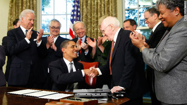President Barack Obama shakes hands with gay rights activist Frank Kameny in June 2009 after signing a memorandum to extend benefits to same-sex partners of federal employees.