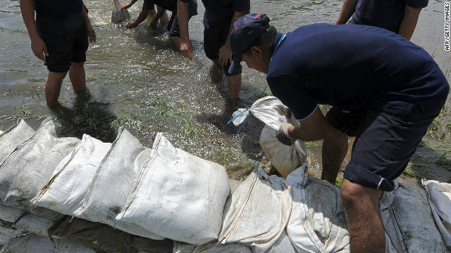 Thai workers prepare sandbags in the event of more flooding in Pathum Thani province, suburban Bangkok, on October 11, 2011.