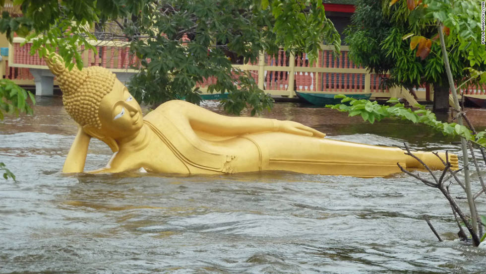A reclining Buddha in the ancient city of Ayutthaya falls foul of rising waters on October 13, 2011.