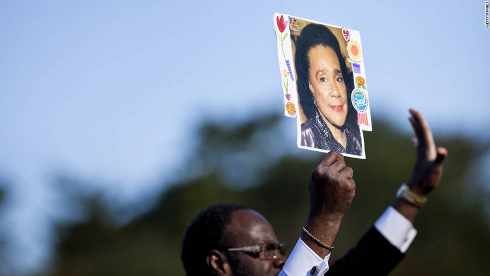 The Rev. Cal H. P. Merrell of Atlanta holds a photo of  the late Coretta Scott King, King's widow, during the  ceremony.