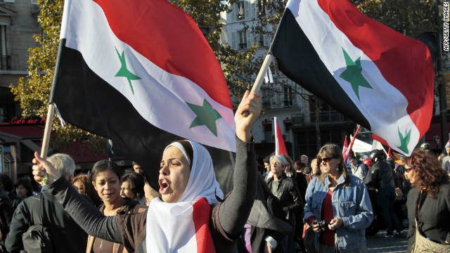 A woman shouts slogans during a demonstration on October 15 in Paris in support of the Syrian people.