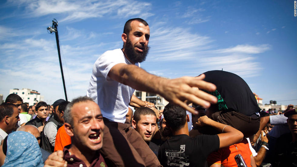 A Palestinian prisoner celebrates with relatives after being freed on Tuesday.