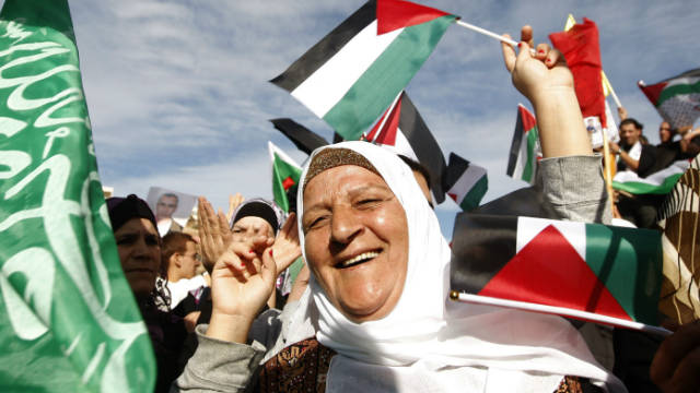 Palestinians celebrate the prisoner swap deal reached between Israel and Hamas near the West Bank city of Ramallah.