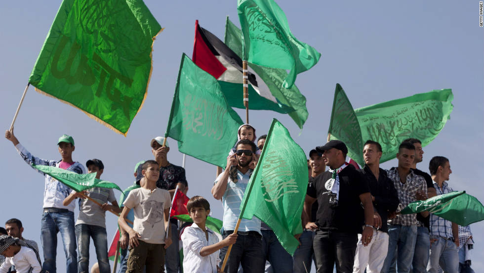 Palestinians celebrate the prisoner swap deal between Israel and Hamas on Tuesday, October 18.  Israeli soldier Gilad Shalit was released Tuesday morning in exchange for 1,027 Palestinian prisoners.