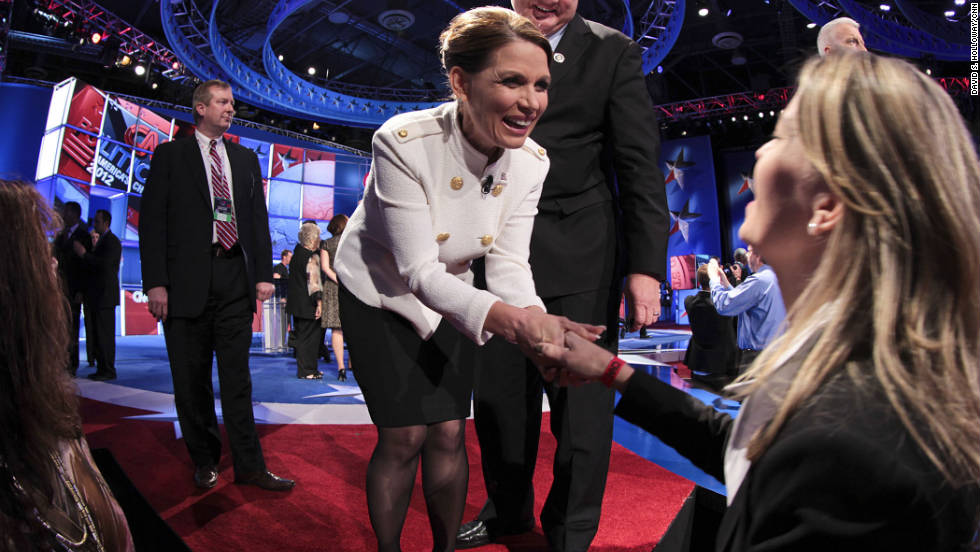 "Minnesota Rep. Michele Bachmann greets debate watchers. ""We need to repeal Obamacare, repeal the jobs and housing destruction act known as Dodd-Frank,"" Bachmann said. ""President Obama's plan has been a plan for destruction for this economy and failure. I plan to change that."""