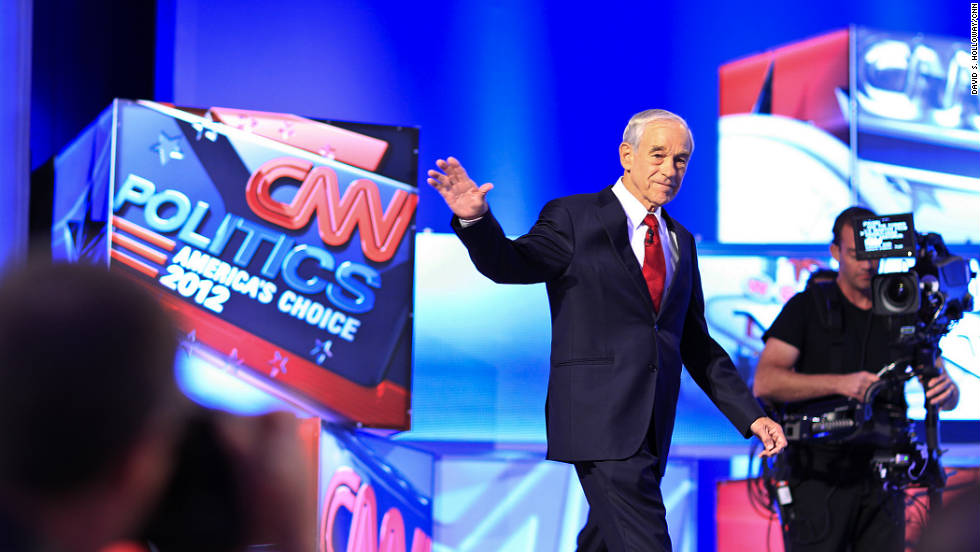 "Rep. Ron Paul of Texas joined the candidates in attacking Cain's tax plan. ""Herman, it's not going to fly. It's very, very dangerous,"" Paul said."