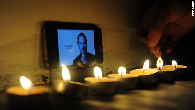 People mourn Apple co-founder Steve Jobs at an Apple store on October 6, 2011, in Beijing, China.