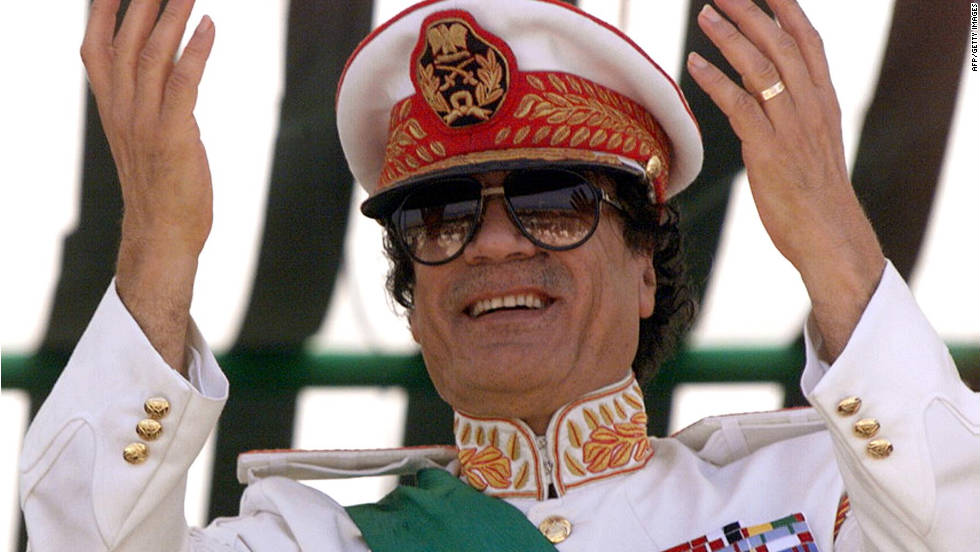 Gadhafi salutes during a 1999 military parade celebrating the 30th anniversary of the Libyan Revolution in Tripoli.