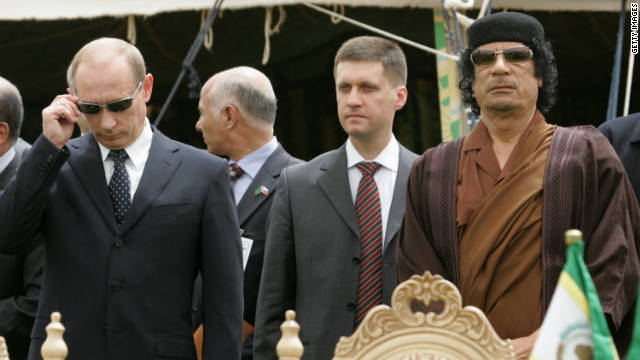 TRIPOLI, LIBYA - APRIL 17: Russian President Vladimir Putin (L) stands next to Libyan leader Muammar Qadaffi (R) during the signing of agreements between the two countries April 17, 2008 in Tripoli, Libya. Putin is in Libya for a two-day official visit to rebuild Russian-Libyan relations.  (Photo by Artyom Korotayev/Epsilon/Getty Images) *** Local Caption *** Muammar Qadaffi;Vladimir Putin