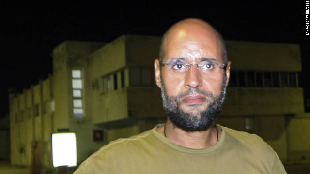 CROPPED VERSION Saif al-Islam Kadhafi, son of Libyan leader Moamer Kadhafi, flashes the V-sign for victory as he appears in front of journalists at his father's residential complex in the Libyan capital Tripoli in the early hours of August 23, 2011. Seif al-Islam, wanted by the International Criminal Court for crimes against humanity and who ICC prosecutor Luis Moreno-Ocampo earlier said had been arrested by the rebels, claimed the insurgents had suffered 'heavy casualties' when they stormed Kadhafi's Bab al-Azizya compound in Tripoli. AFP PHOTO/IMED LAMLOUM (Photo credit should read IMED LAMLOUM/AFP/Getty Images)Date created: 	23 Aug 2011Editorial image #: 	121888096Restrictions: 	Contact your local office for all commercial or promotional uses. Full editorial rights UK, US, Ireland, Italy, Spain, Canada (not Quebec). Restricted editorial rights elsewhere, please call local office.CROPPED VERSIONLicense type: 	Rights-managedPhotographer: 	AFP/StaffCollection: 	AFPCredit: 	AFP/Getty ImagesMax file size/dimensions/dpi: 	27.9 MB - 2645 x 3690 px (8.82 x 12.30 in.) - 300 dpiDownload file size may vary.Source: 	AFPRelease information: 	Not released. More informationBar code: 	AFPObject name: 	Nic603295Copyright: 	2011 AFPKeywords: 	Complex, Time, Leadership, Success, Vertical, Libya, Father, Son, Bright, Part Of, Journalist, Politics, Peace Sign, Males, Residential Structure, Morning, Capital Cities, Tripoli - Libya, Muammar Gaddafi, Appearance, Saif al-Islam Gaddafi, Libyan Civil War. Find similar imagesAvailability: 	Availability for this image cannot be guaranteed until time of purchase.Editorial subscription downloadDownload This item is available for download based on your license agreement.Select keywords to find similar imagesTip: Select fewer keywords to get more results. (Only images that match all of the keywords you select will be shown.)SubjectAppearance	Bright	Capital CitiesComplex	Father	JournalistLibyan Civil War	Part Of	Peace SignPolitics	Residential Structure	SonPeopleMales	Muammar Gaddafi	Saif al-Islam GaddafiLocationLibya	Tripoli - Libya	ConceptLeadership	Morning	SuccessTime		StyleVertical		Getty Images reserves the right to pursue unauthorized users of this image or clip. If you violate our intellectual property you may be liable for: actual damages, loss of income, and profits you derive from the use of this image or clip, and, where appropriate, the costs of collection and/or statutory damages up to $150,000 (USD).	Subscription downloadAdd to cartAdd to lightboxPrint preview imageDownload preview imageView terms of useSearch for more images like thisResources    Choosing the right keywords        About our search features        Chat is currently not available    Questions? Please Contact Us.	Live chat