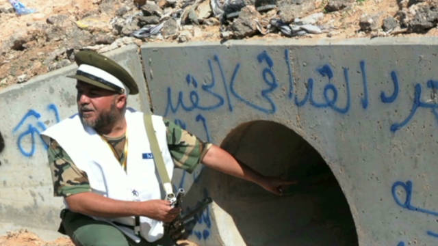 Gadhafi was hiding in drainage pipe