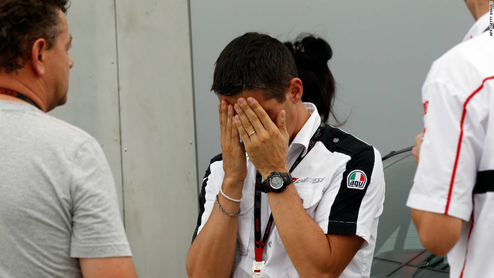 Crew members of Simoncelli's Honda team are left distraught by the tragic events.