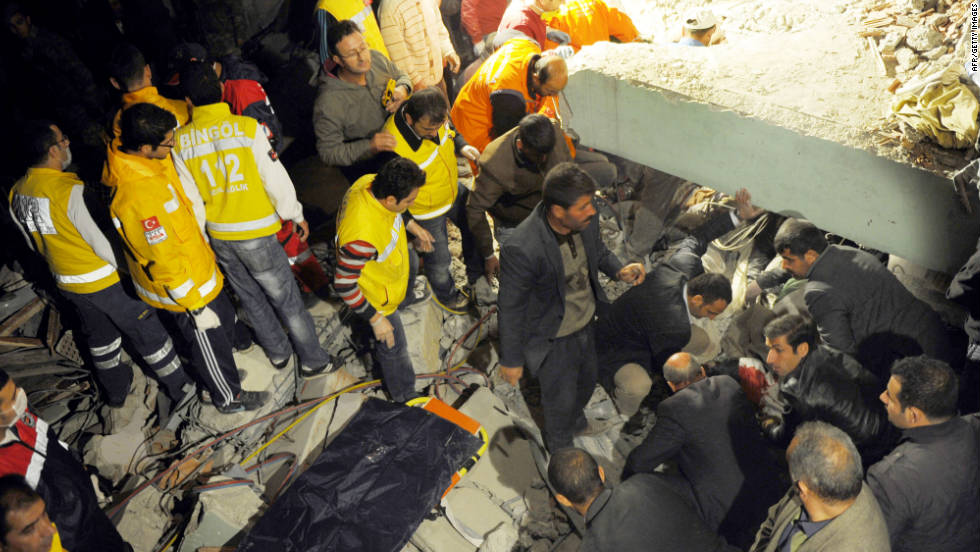 Citizens and rescue workers sift through the rubble looking for survivors in Ercis, Turkey, on Sunday.