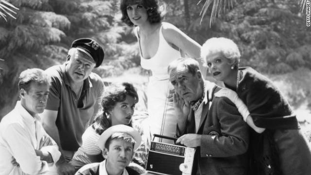 "The cast of the TV comedy series ""Gilligan's Island,"" which ran from 1964-1967, listens to a shortwave radio in a promotional photo."